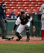 2007:  David Wallace of the Buffalo Bisons picks up a blocked ball while checking on the runner vs. the Ottawa Lynx in International League baseball action.  Photo copyright Mike Janes Photography 2007.