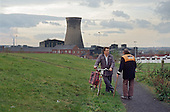 Miners in front of the coal-fired power station and colliery (both now demolished) in the village of Grimethorpe, South Yorkshire.