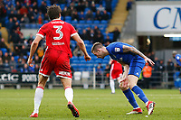 Joe Ralls of Cardiff City is tackled by George Friend of Middlesbrough after he delays a free kick late in the Sky Bet Championship match between Cardiff City and Middlesbrough at the Cardiff City Stadium. Cardiff, Wales, UK. Saturday 17 February 2018