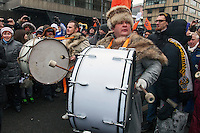 Moscow, Russia, 13/01/2013..Russian nationalist drummers join thousands of opposition protesters who carried posters of President Vladimir Putin and members of the Russian parliament with the word ?Shame? written in red at a protest called the March Against The Scoundrels. The protest was against the new law banning the adoption of Russian children by Americans, widely seen as a response to the recently passed USA Magnitsky Act.