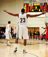 21 January 2010: University of Vermont Catamount forward Marqus Blakely, a Senior from Metuchen, NJ, defends against the Stony Brook University Seawolves at Patrick Gymnasium in Burlington, Vermont. The Catamounts fell to the Seawolves 65-60 in the America East matchup. Mandatory Credit: Ed Wolfstein Photo