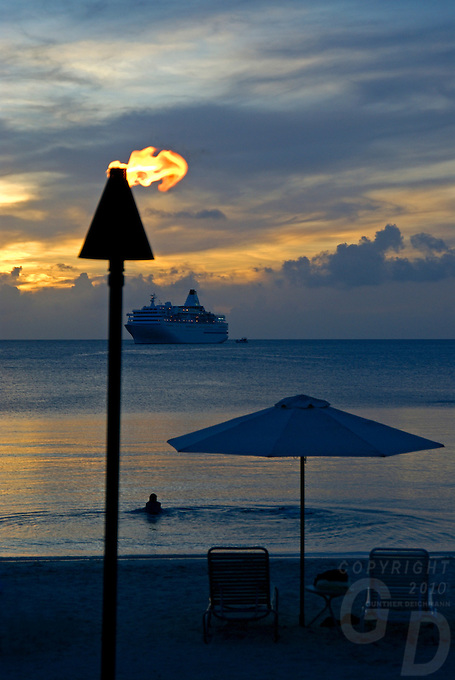 A HUGE CRUISE LINER OFF THE BEACH IN PALAU, MICRONESIA AT SUNSET
