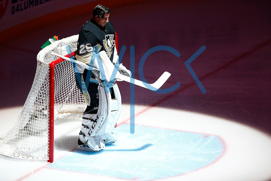 Marc Andre-Fleury #29 of the Pittsburgh Penguins stands during the national anthem prior to the start of the game against the Colorado Avalanche at Consol Energy Center on November 19, 2015. (Photo by Jared Wickerham/DKPittsburghSports)