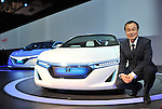 November 30, 2011, Tokyo, Japan - Takanobu Ito, president of Honda, poses for photographers beside its first plug-in hybrid, AC-X, during a press preview of the Tokyo Motor Show on Wednesday, November 30, 2011...The Tokyo Motor Show opened to the press Wednesday as Japanese automakers unveiled a bevy of electric cars and other green vehicles at a much smaller venue in central Tokyo, to which the show moved from the nations largest exhibition hall in neighboring Chiba prefecture after 24 years. A total of 176 brands from 13 countries and regions participated in the show. The number of foreign automakers has increased to 24 from previous nine. Out of 398 models, 52 will be shown for the very first time. An estimated 800,000 visitors are expected to attend the week-long exhibition, compared with 1.5 million in 2005, according to the organizers.(Photo by Natsuki Sakai/AFLO) [3615] -mis-.