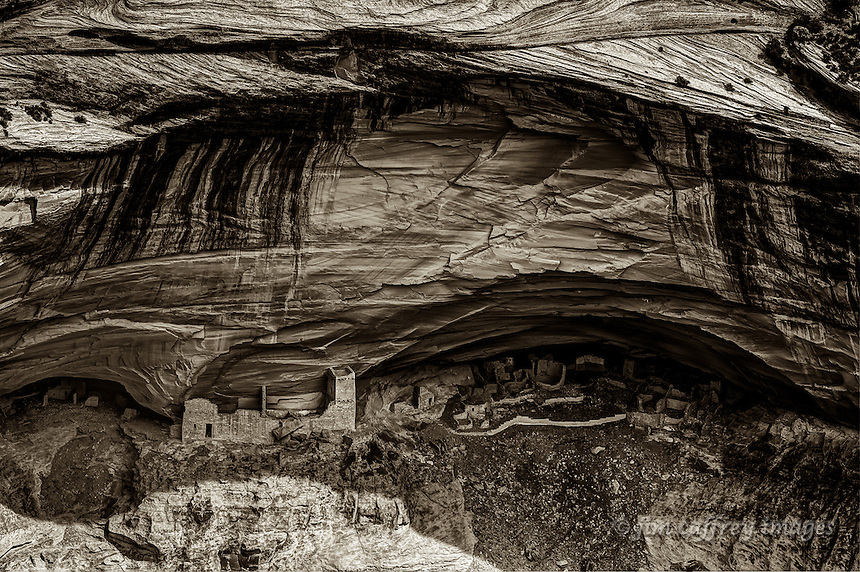 A sepia toned image of the Mummy House Ruin in the Canyon del Muerto section of Canyon de Chelly.