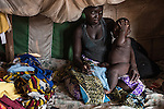 RCA, BANGUI: A young woman is sitting in her tent of the Mpoko camp with her child. <br /> CAR, BANGUI: 27th April 2016: Une jeune femme est assise dans sa tente du camp Mpoko avec son enfant.
