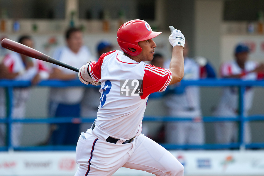 27 September 2009: Ariel Pestano of Cuba hits the ball during the 2009 Baseball World Cup gold medal game won 10-5 by Team USA over Cuba, in Nettuno, Italy.