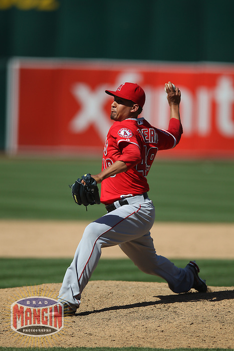 OAKLAND, CA - MAY 1:  Ernesto Frieri #49 of the Los Angeles Angels pitches during the game against the Oakland Athletics at O.co Coliseum on May 1, 2013 in Oakland, California. Photo by Brad Mangin
