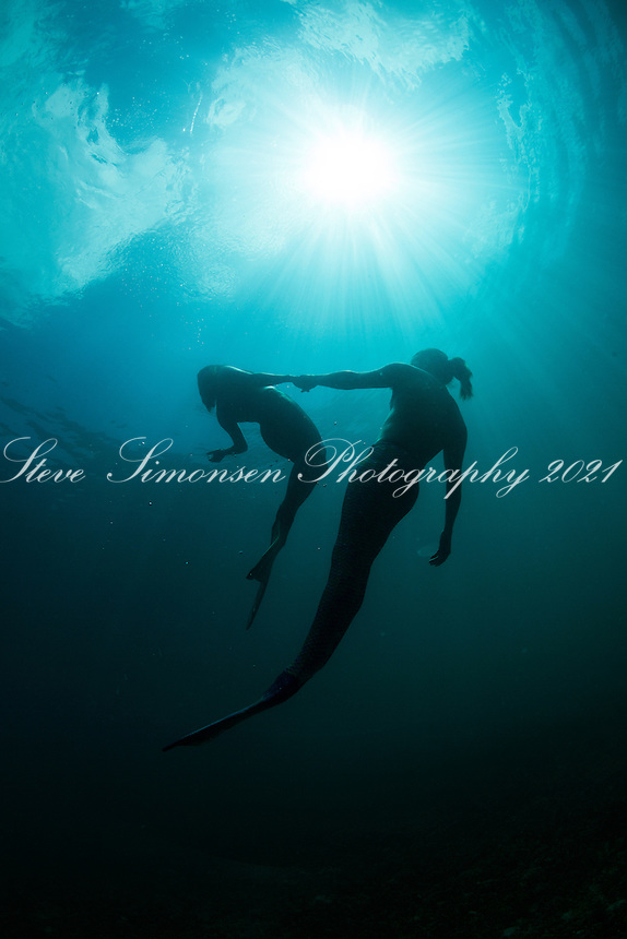 Blue water mermaid couple <br /> Mosquito Pier<br /> Vieques