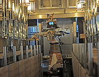 Samurai robot waiter slides in the restaurant to serve food in the Hajime Restaurant, out-skirts of Bangkok, Thailand. Hajime is a Japanese restaurant in Thailand, has samurai style robot serving food to the diners and even do a dance session to entertain guests. This robot are made in Japan and costed about 86,600,000 yen (1,063,717USD). Customers order food from touch panel and Samurai robot will bring ordered food to their table.<br /> 15 Oct 2010