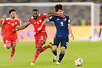 Minamino Takumi of Japan (R) fights for the ball with Saad Al Mukhaini of Oman (L) during the AFC Asian Cup UAE 2019 Group F match between Oman (OMA) and Japan (JPN) at Zayed Sports City Stadium on 13 January 2019 in Abu Dhabi, United Arab Emirates. Photo by Marcio Rodrigo Machado / Power Sport Images