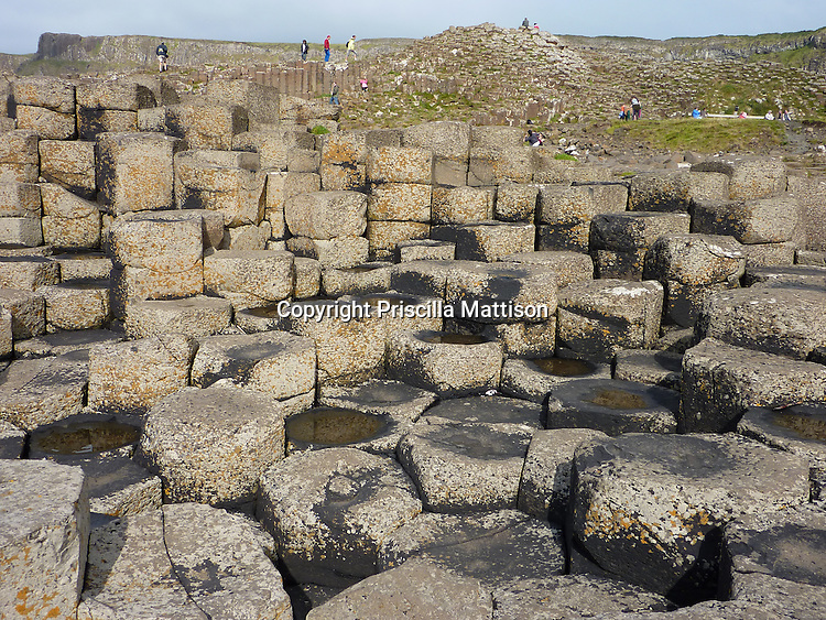 County Antrim, Northern Ireland - July 14, 2010:  Basalt columns rise at the Giant's Causeway.