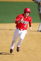 Josh Gardiner (10) of the Radford Highlanders hustles towards third base against the Missouri Tigers at Wake Forest Baseball Park on February 21, 2014 in Winston-Salem, North Carolina.  The Tigers defeated the Highlanders 15-3.  (Brian Westerholt/Four Seam Images)