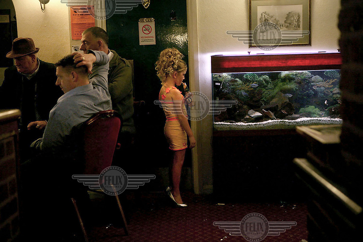 Savannah Sheridan looks into a fish-tank in the Duke of York pub. The pub was visited almost exclusively by Irish Travellers living on a site nearby. After the Travellers were evicted the lack of custom forced the pub to close down.