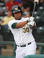 Outfielder Geraldo Rodriguez (30) of the Lynchburg Hillcats, Carolina League affiliate of the Atlanta Braves, in a game against the Wilmington Blue Rocks on June 15, 2011, at City Stadium in Lynchburg, Va. (Tom Priddy/Four Seam Images)