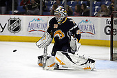 February 17th 2007:  Ryan Miller (30) of the Buffalo Sabres stops a puck during warm-ups before a game vs. the Boston Bruins at HSBC Arena in Buffalo, NY.  The Bruins defeated the Sabres 4-3 in a shootout.