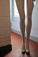 Mannequin legs standing by window, kitchen (Licence this image exclusively with Getty: http://www.gettyimages.com/detail/97659143 )