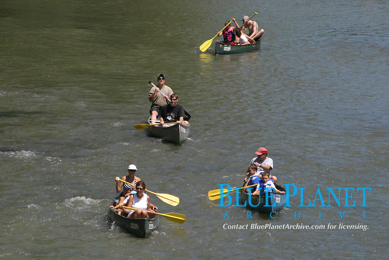 Canoers enjoy a relaxing day of outdoor fun on the Little Miami River in central Ohio. (no MR)