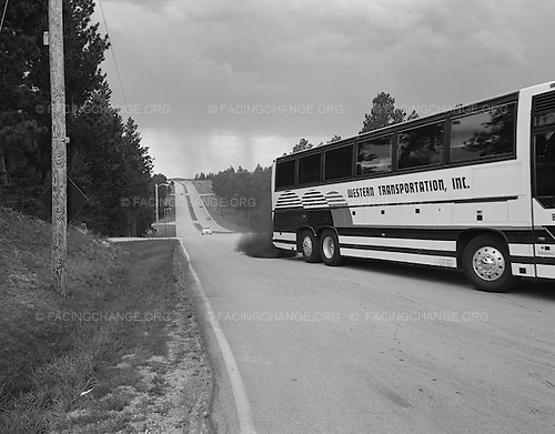 Custer, South Dakota<br /> July 26, 2011<br /> <br /> A tourist bus spews exhaust fumes on its way to the Crazy Horse Monument in the Black Hills.