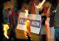TITLE - DISTANT RELATIONS, ISRAELIS OPPOSED TO PEACE AND ISRAELI GOVERNMENT BURN A PEACE BANNER IN PROTEST,. JERUSALEM ISRAEL.