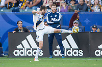 CARSON, CA - SEPTEMBER 29: Dave Romney #4 of the Los Angeles Galaxy crosses a ball during a game between Vancouver Whitecaps and Los Angeles Galaxy at Dignity Health Sports Park on September 29, 2019 in Carson, California.