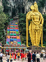 Batu Caves, Tourists,  Hindu God Marugan, God of War, and Steps leading to Caves, Selangor, Malaysia.