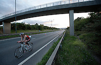 16 AUG 2014 - DARTFORD, GBR - Susan Fairfax from Crystal Palace Triathletes races along a closed lane of Bob Dunn Way during the 2014 Midnight Wo/Man triathlon in Dartford, Great Britain (PHOTO COPYRIGHT © 2014 NIGEL FARROW, ALL RIGHTS RESERVED)