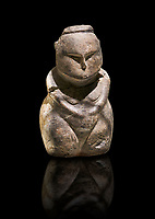 Styalised stone fiqurine. Catalhoyuk Collections. Museum of Anatolian Civilisations, Ankara. Against a black background