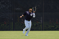 FCL Yankees outfielder Jasson Dominguez (25) catches a fly ball during a game against the FCL Blue Jays on June 29, 2021 at the Yankees Minor League Complex in Tampa, Florida.  (Mike Janes/Four Seam Images)