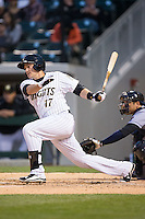Jason Coats (17) of the Charlotte Knights follows through on his swing against the Scranton\Wilkes-Barre RailRiders at BB&T BallPark on May 1, 2015 in Charlotte, North Carolina.  The RailRiders defeated the Knights 5-4.  (Brian Westerholt/Four Seam Images)