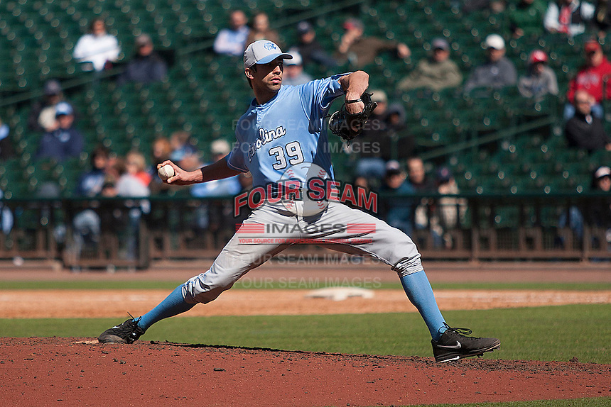 North Carolina Tar Heels starting pitcher Benton Moss #39 delivers a pitch to the plate against the California Golden Bears in the NCAA baseball game on March 2nd, 2013 at Minute Maid Park in Houston, Texas. North Carolina defeated Cal 11-5. (Andrew Woolley/Four Seam Images).