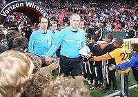 Referees enter the field during an MLS match between D.C. United and the Chicago Fire on April 17 2010, at RFK Stadium in Washington D.C. Fire won 2-0.