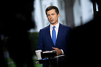 United States Secretary of Transportation Pete Buttigieg participates in a television interview at the White House in Washington, DC, October 13, 2021. Credit: Chris Kleponis / Pool via CNP /MediaPunch