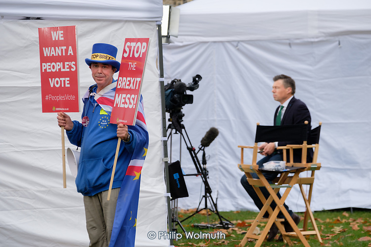 Steve Bray. Anti Brexit protester attempts to get in shot of TV cameras on College Green, Westminster, London, on the day of four ministerial resignations over Brexit deal.