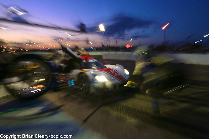 The #5 Chevrolet Corvette DP of Joao Barbosa, Christian Fittipaldi and Sebastien Bourdais makes a pit stop during the 12 Hours of Sebring, Sebring International Raceway, Sebring, FL, March 2014.  (Photo by Brian Cleary/www.bcpix.com)