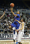 Bishop Gorman's Rashad Muhammad goes up for a shot past Hug defender Jhalil Roscom during the NIAA 4A State Basketball Championship game between Bishop Gorman and Hug high schools at Lawlor Events Center, in Reno, Nev, on Friday, Feb. 24, 2012. Bishop Gorman won 96-51..Photo by Cathleen Allison