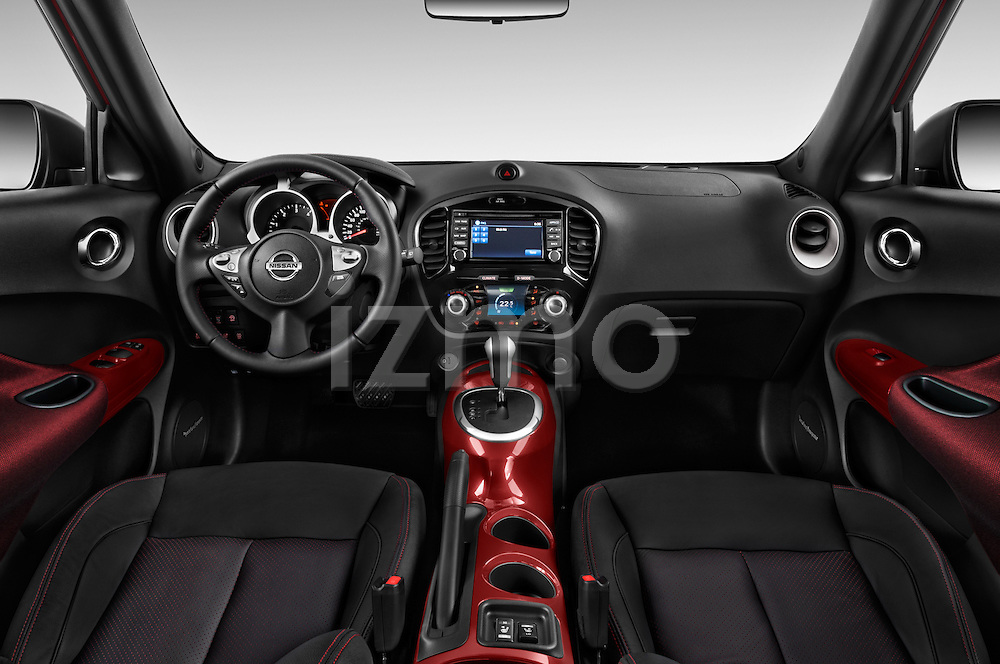 Stock photo of straight dashboard view of 2015 Nissan Juke Acenta 5 Door Suv Dashboard