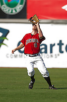Right fielder Jared Prince #8 of the Hickory Crawdads makes a catch against the Greensboro Grasshoppers at  L.P. Frans Stadium July 10, 2010, in Hickory, North Carolina.  Photo by Brian Westerholt / Four Seam Images