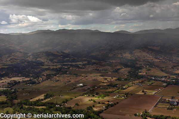 aerial photograph rain showers along the Silverado Trail and Atlas Mountains, Napa Valley,  Napa County, California
