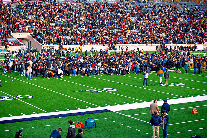 """November 23, 2019: Yale defeated Harvard in double overtime 50-43, in a contest marked by a """"fossil fuel"""" protest. It was at halftime of the 136th Ivy League meeting as the """"sit-in"""" with over 800 took place on the football field at the Yale Bowl in New Haven, Connecticut. Dan Heary/Eclipse Sportswire/CSM"""