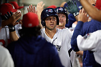 Binghamton Mets right fielder Tim Tebow (15) high fives teammates after hitting a three run home run to tie the game in the bottom of the sixth inning a game against the Erie SeaWolves on May 14, 2018 at NYSEG Stadium in Binghamton, New York.  Binghamton defeated Erie 6-5.  (Mike Janes/Four Seam Images)