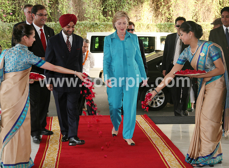 **ALL ROUND PICTURES FROM SOLARPIX.COM**.**WORLDWIDE SYNDICATION RIGHTS**.Hillary Clinton on her visit to India. 19 July 2009..This pic: Hillary Clinton being welcomed at ITC Maurya Hotel in New Delhi..JOB REF: 9586 SJA        DATE: 19_07_2009.**MUST CREDIT SOLARPIX.COM OR DOUBLE FEE WILL BE CHARGED**.**MUST NOTIFY SOLARPIX OF ONLINE USAGE**.**CALL US ON: +34 952 811 768 or LOW RATE FROM UK 0844 617 7637**