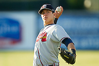Joey Meneses (34) of the Rome Braves warms up in the outfield prior to the game against the Kannapolis Intimidators at CMC-Northeast Stadium on August 24, 2013 in Kannapolis, North Carolina.  The Intimidators defeated the Braves 6-1.  (Brian Westerholt/Four Seam Images)