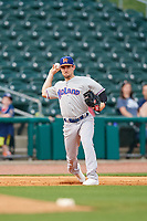 Midland RockHounds third baseman Jordan Tarsovich (5) throws to first base during a game against the Northwest Arkansas Naturals on May 27, 2017 at Arvest Ballpark in Springdale, Arkansas.  NW Arkansas defeated Midland 3-2.  (Mike Janes/Four Seam Images)