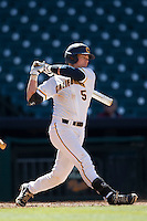 California Golden Bears catcher Andrew Knapp #5 follows through on his swing against the North Carolina Tar Heels in the NCAA baseball game on March 2nd, 2013 at Minute Maid Park in Houston, Texas. North Carolina defeated Cal 11-5. (Andrew Woolley/Four Seam Images).