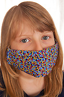 Young Girl with fun medical mask poke dot desing