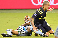 KANSAS CITY, KS - OCTOBER 11: Amadou Dia #13 of Sporting Kansas City wins the ball from Randall Leal #8 of Nashville SC during a game between Nashville SC and Sporting Kansas City at Children's Mercy Park on October 11, 2020 in Kansas City, Kansas.