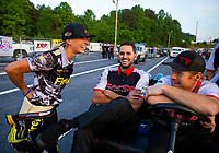 May 4, 2018; Commerce, GA, USA; NHRA top fuel driver Leah Pritchett (left) talks with husband Gary Pritchett , crew member for Steve Torrence (not pictured) during qualifying for the Southern Nationals at Atlanta Dragway. Mandatory Credit: Mark J. Rebilas-USA TODAY Sports