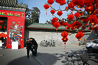 CHINA. Scene during Chinese New Year in Ditan Park in Beijing.  Chinese New Year, or Spring Festival, is the most important festival and holiday in the Chinese calendar In mainland China, many people use this holiday to visit family and friends and also visit local temples to offer prayers to their ancestors. The roots of Chinese New Year lie in combined influences from Buddhism, Taoism, Confucianism, and folk religions.  2008