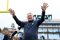 CHAPEL HILL, NC - OCTOBER 10: North Carolina head coach Mack Brown is waives to the fans while being interviewed by ESPN before a game between Virginia Tech and North Carolina at Kenan Memorial Stadium on October 10, 2020 in Chapel Hill, North Carolina.